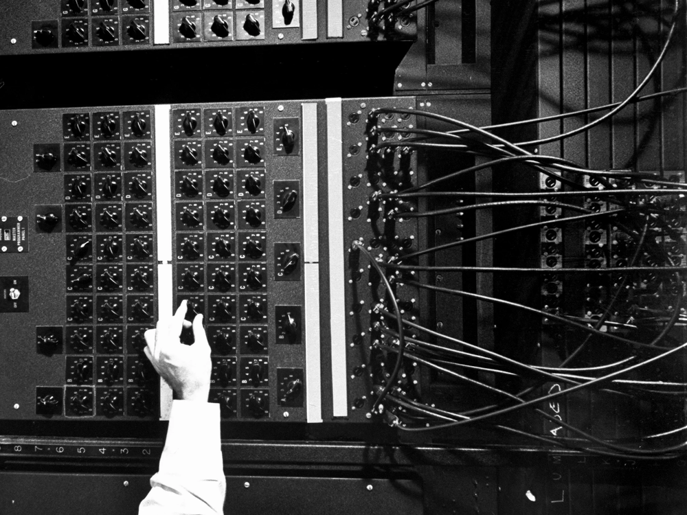 ENIAC, the very first computer, required operators to manually program instructions with a complex web of switches and cables.  Source:  https://www.wired.com/2014/11/eniac-unearthed/